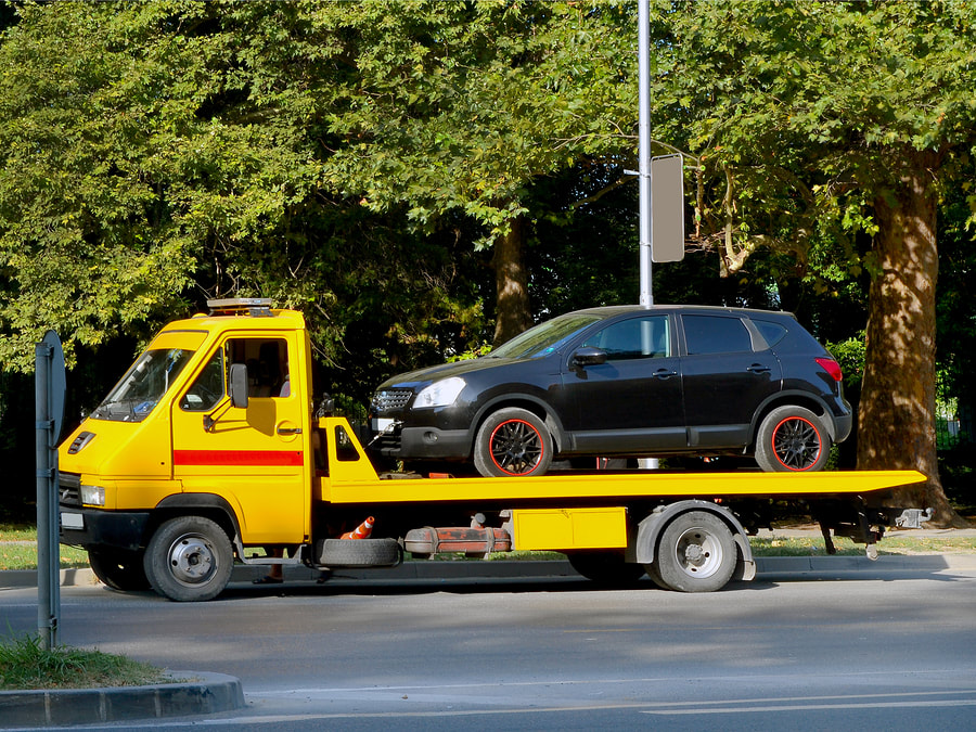 black car on the towing truck